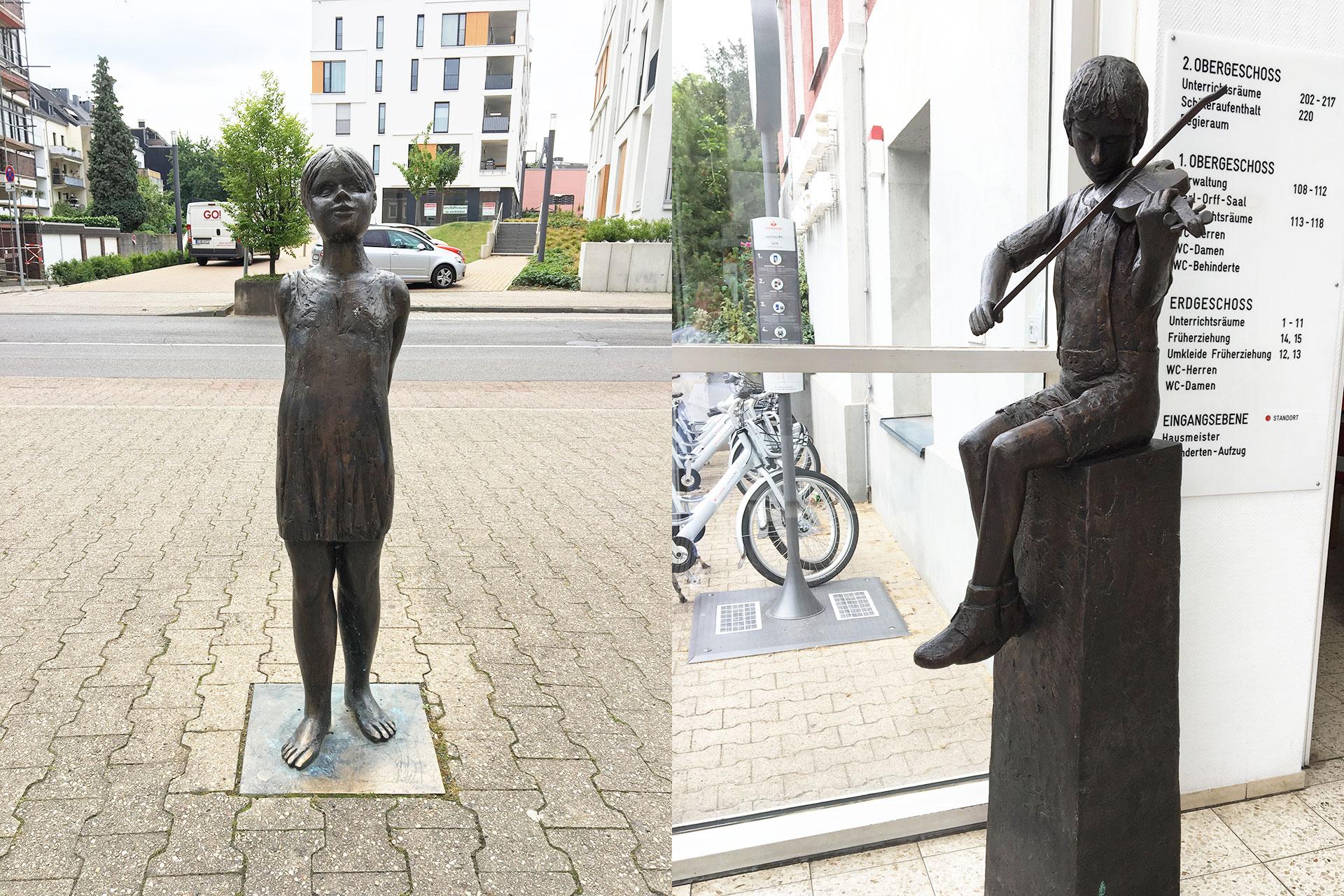Bronzeskulpturen von Renate Fellner vor und in der Musikschule